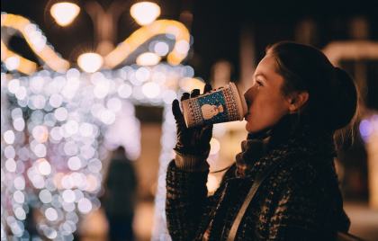 Christmas Market in Krakow- girl drinking mulled wine on the Christmas Market.