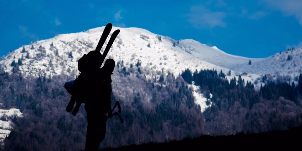 Visit Krakow to become skier standing in front of white mountain.